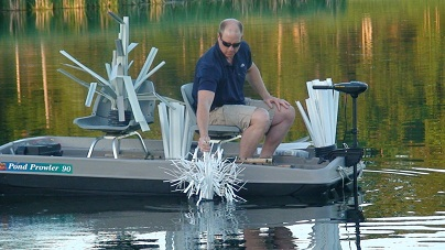 """""""Retired NFL veteran and Fishiding customer, Aaron Graham, placing our products in his private pond in Gretna, Nebraska""""."""
